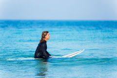 Ready to hit waves. A young surfer with his board on the beach Stock Photography