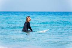 Ready to hit waves. A young surfer with his board on the beach Royalty Free Stock Photos