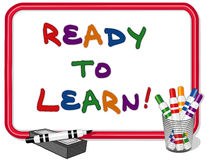 Ready To Learn Whiteboard. Ready to Learn text on red frame whiteboard with multicolored marker pens and dry eraser. For daycare, preschool, kindergarten, grade Royalty Free Stock Photo