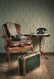 Ready to leave. Male hat and suitcases on elegant armchair in a vintage style room Royalty Free Stock Image