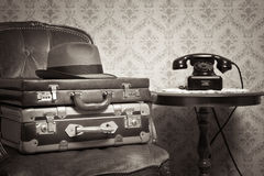 Ready to leave. Male hat and suitcases on elegant armchair in a vintage style room Royalty Free Stock Photo