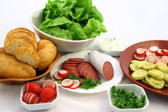 Ready to make sandwiches. Lot of fresh sandwich's ingredients put in bowls and on plates Stock Photos