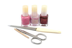 Ready to Manicure. Choice of pretty pinks and purple nail colours and a manicure set. Focus is on the scissors stock photos