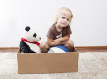 Ready to move. Angry little girl - have to move Royalty Free Stock Photography