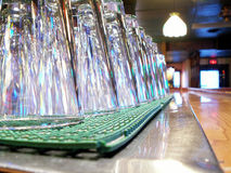 Ready to open. Abstract of bar counter with clean glasses ready for beer royalty free stock images