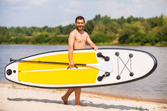 Ready to paddle. Stock Photos