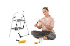 Ready to paint. Beautiful young woman getting her painting tools ready Stock Image
