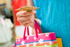 Ready to pay. Image of female holding card in hand ready to pay for her shopping Stock Images