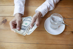 Ready to pay with dollar banknotes Stock Photos