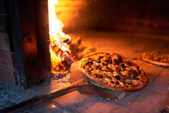 Ready To Pick Up Pizza Oven With Fire On Blade. Stock Images