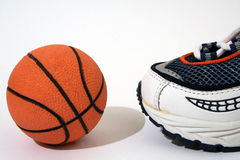 Ready to play !. Sport shoe and a basketball Royalty Free Stock Photo