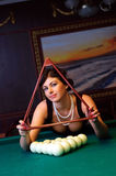 Ready to play billiards. Luxurious woman is ready to play billiards Royalty Free Stock Photography
