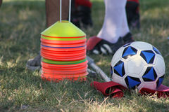 Ready to play soccer. Cones and soccer ball Stock Images