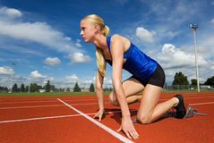 Ready to race. A teen athlete ready to race in the starting blocks Stock Photography