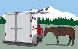 Ready to Ride. Horse tied to trailer in wilderness prior to ride Royalty Free Stock Images