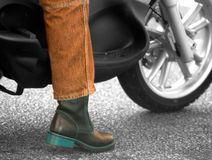 Ready to ride. Person ready to ride motorcycle, Jeans and Boot Royalty Free Stock Image
