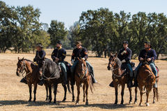 Ready to Ride into Action. Anderson, California, USA- October 4, 2015: Five Union  Army cavalry scouts wait to join the battle at the Civil War reenactment at Royalty Free Stock Images