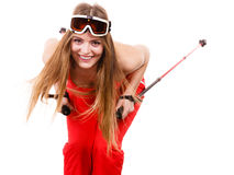 Ready to ride woman wearing ski suit holding poles Stock Photography