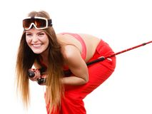 Ready to ride woman wearing ski suit holding poles Royalty Free Stock Photo