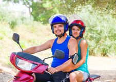 Ready to roll. Happy couple on a motor scooter going to a fun trip in Greece, Kefalonia Royalty Free Stock Photography