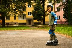 Ready to roller skating. Cute boy with helmet ready to roller skating Royalty Free Stock Images