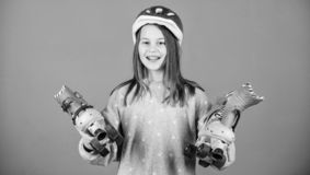 Ready to roller skating. Girl cute teen wear helmet and roller skates on violet background. Active leisure and lifestyle royalty free stock photos