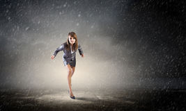 She is ready to run this race. Young determined businesswoman on road standing in start position Royalty Free Stock Images
