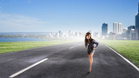 Ready to run. Young determined businesswoman standing in start position Royalty Free Stock Photos