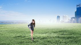 Ready to run. Young determined businesswoman standing in start position Royalty Free Stock Images