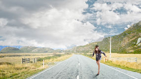 Ready to run. Young determined businesswoman standing in start position Stock Photo