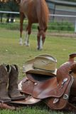 Ready to Saddle up. Western gear with horse in background Stock Images