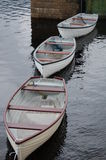 Ready to sail. Three rowing boats on the remote Loch Katrine, Scotland Royalty Free Stock Photo