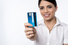 Ready to shop with credit card !. Happy woman showing credit card, focus on card Stock Photo
