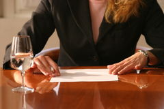 Ready to sign. Woman reading the contract and ready to sign Stock Photo