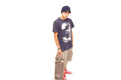 Ready to skate???. Skater posing with a skateboard on white background Royalty Free Stock Photo