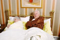 Ready to Sleep. A retired couple getting ready to sleep Royalty Free Stock Images