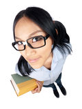 Ready to Study. A nerdy Asian girl holding a book and looking into the camera shot with a wide angle lens Royalty Free Stock Photography