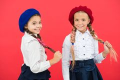 Ready to study. Education abroad. kid fashion. friendship and sisterhood. best friends. little girls in french beret. International exchange school program royalty free stock photography