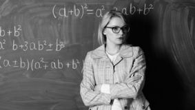 Ready to study. teacher on school lesson at blackboard. woman in classroom. School. Home schooling. serious woman. Back stock photography