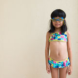 Ready to swim. Little girl wearing swimming suit and goggles ready to swim royalty free stock images