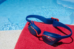 Ready to swim. Swimming gear by side of pool Royalty Free Stock Image