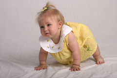 Ready to take a stand. Crawling baby trying to stand up Stock Photo