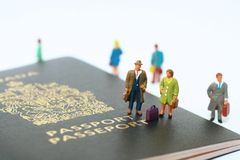 Ready to travel. Mini people standing on canadian passport ready to travel Royalty Free Stock Photo