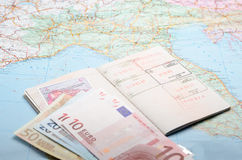 Ready to travel. Passports and money over map background