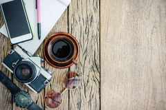 Ready to travel, coffee cup,camera, glass, phone, pen, note and Royalty Free Stock Images