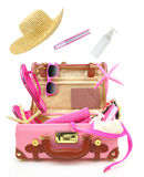 Ready to travel open pink suitcase. With summer equipment Stock Photos