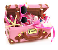 Ready to travel pink suitcase. With summer equipment isolated Stock Images