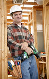 Ready To Work. A handsome construction worker on the jobsite with his tools, ready to work.  Authentic and accurate content depiction Stock Image