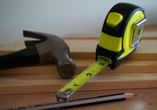 Home Improvement Tools - Hammer, Tape Measure, and Boards Stock Image