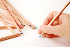 Ready to write. Human hand ready to write with color pencils royalty free stock photography